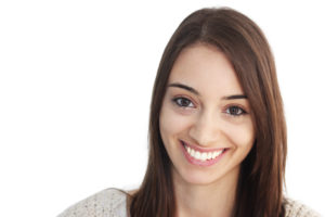 Photo of a woman smiling with straight, white teeth