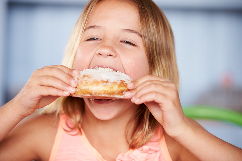 child eating a sugary treat