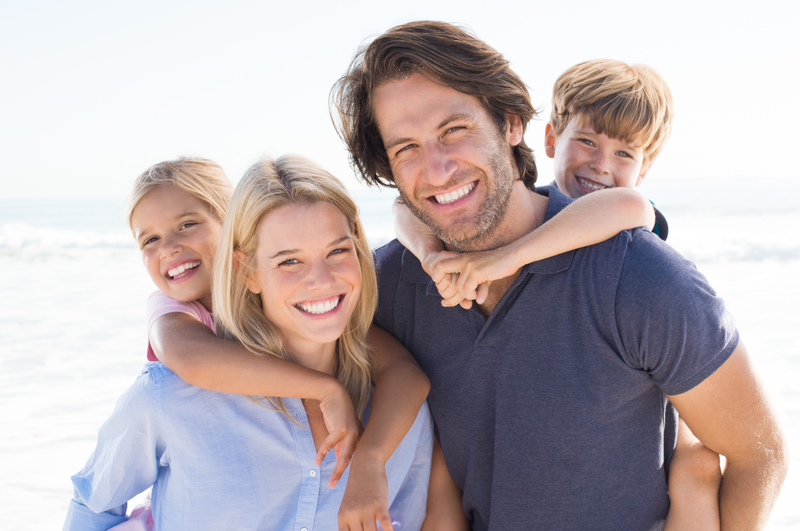 Family of four smiling