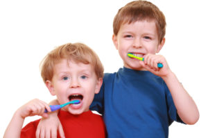 two small boys brushing their teeth