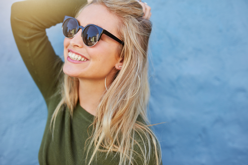Blonde woman wearing glasses and smiling
