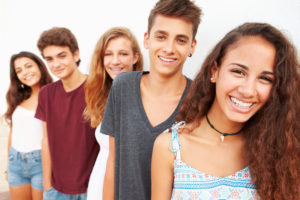 Group of people smiling, some with braces.