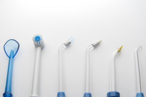 Picture of different types of waterpiks and teeth cleaning apparatuses