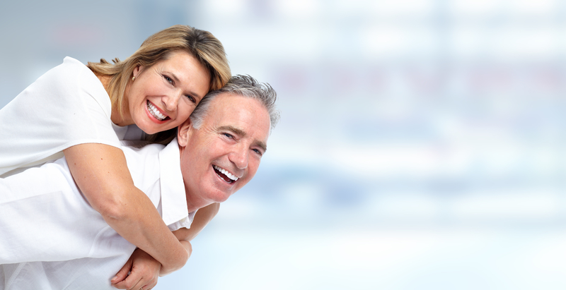 Smiling senior couple in front of blue background