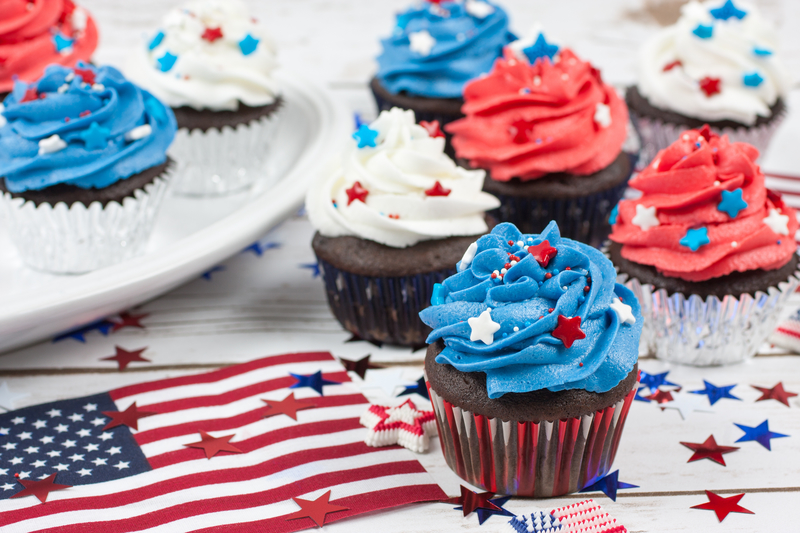 Chocolate cupcakes decorated in red, white and blue with an American flag
