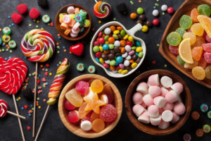 Colorful candies, lollipops and gummies